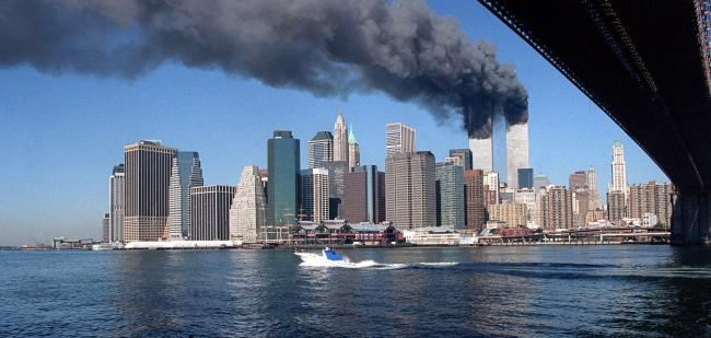 Smoke billows from the towers of the World Trade Center in New York, Tuesday, Sept. 11, 2001.