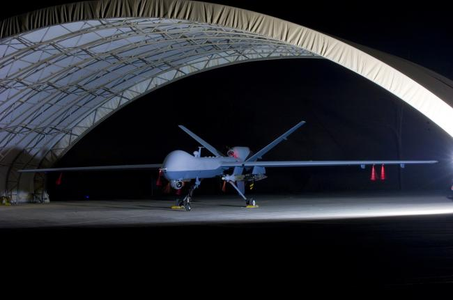 An armed MQ-9 Reaper unmanned aerial vehicle sits in a shelter on Joint Base Balad, Iraq, Oct. 15, 2008, prior to a mission. Larger and more powerful than the MQ-1 Predator, the Reaper can carry up to 3,750 pounds of laser-guided bombs and Hellfire missiles. The Reaper is assigned to the 46th Expeditionary Reconnaissance and Attack Squadron.
