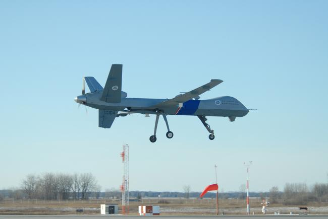 The U.S. Customs and Border Protection's first MQ-9 Predator B unmanned aerial vehicle to be stationed along the northern border of the United States lands at Grand Forks Air Force Base, N.D., Dec. 6, 2008.  The vehicle will be maintained at the base and is slated to begin operational flights as early as January 2009. The vehicle will be used to enhance security along the border between the United States and Canada.