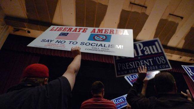 Supporters of Ron Paul hold up signs during a town hall event at the University of Minnesota on Friday, Sept. 25, 2009. Rep. Ron Paul's comments about monetary reform and personal liberty received the biggest applause.