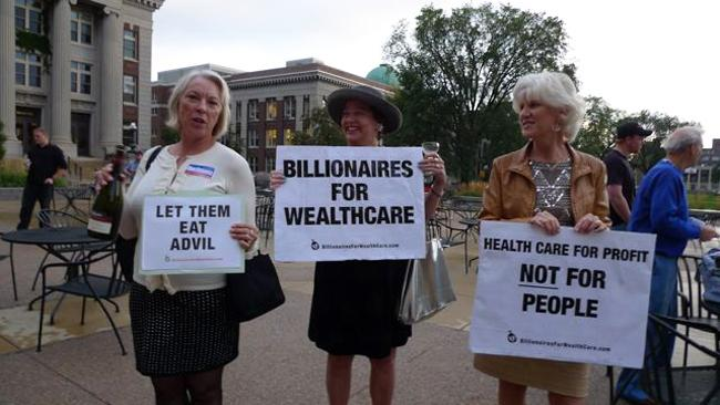 Members of Billionaires for Wealthcare, a satirical street theater group, protesting conservative opposition to health care reform at a town hall event at the University of Minnesota, Friday, Sept. 25, 2009.