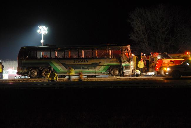Towing crews prepared Wednesday night to move the badly damaged tour bus that rolled over into a ditch along Interstate 90. The coach was on its way from an Iowa casino back to the Rochester area. Twenty three people were injured in the crash, two of them fatally. Two more were in critical condition, although the driver was not among them. He was listed in serious condition at St. Mary's Hospital in Rochester, and had spoken to authorities about the crash. MPR Photo/Tim Nelson