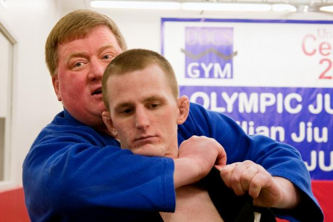 Jay Drangeid demonstrates a hold on volunteer instructor Nate Antinozzi before a class at Docs Gym in Minneapolis Tuesday, Dec. 29, 2009.