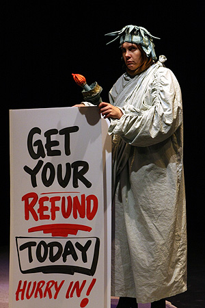 Photo: #An actor portrays a sign holder dressed as the Statue of Liberty in