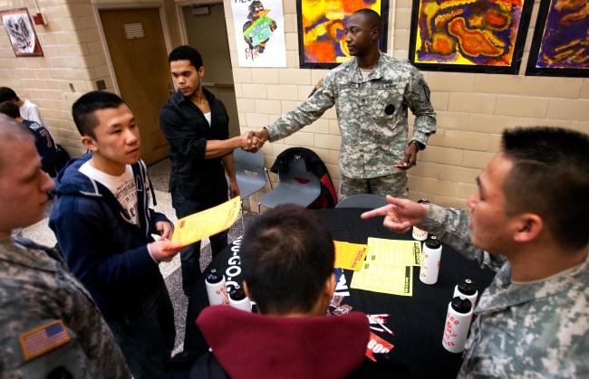 Photo: #Osseo High School senior Christopher Christie shakes hands with Sgt.