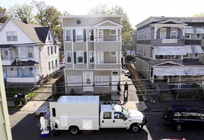 Law enforcement and FBI agents remove evidence from a house in Bridgeport, Conn. on Tuesday, May 4, 2010.where Times Square plot suspect Faisal Shahzad lived.