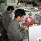 http://images.publicradio.org/content/2010/06/22/20100622_chinese-light-factory-workers_18.jpg