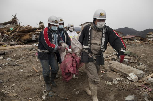 Japanese rescue workers carry