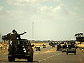 Libyan rebels retreat with their injured