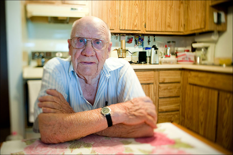 Earl Komis, 94, of Ortonville, Mn., lives on his own in an apartment complex. He receives $651 a month from social security, but it falls $200 short of what he needs monthly. To make up the difference, Komis finds jobs in the community. Until recently he worked as a museum tour guide. Komis receives food once a month from the NAPS program, and also attends the senior dining service in town. He vividly recounted a story during the Great Depression when he was 15 years old, had not eaten for a day-and-a-half, and waited by the roadside for help. Despite his limited income, nothing these days can compare to how he struggled back then, Komis says.