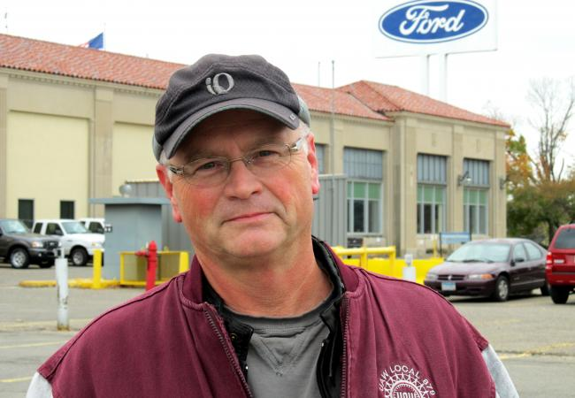 Herb Lynch has worked at the Ford Assembly Plant in St. Paul, Minn., for 12 years. He installs tires on Ford Rangers. Lynch took a buyout from Ford in 2007, but then came back as a temporary worker when the closure was delayed. Lynch is pictured in the plant parking lot, Oct. 18, 2011.