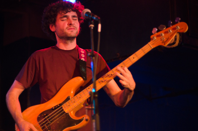 Bassist Chris Bierden of Polica performing at the Turf Club.