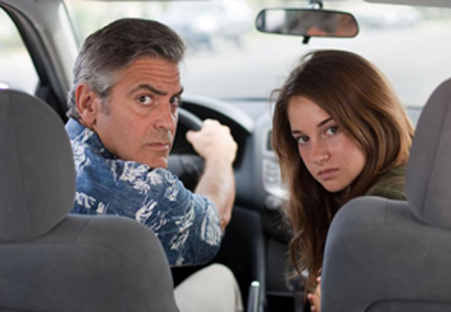 "George Clooney as Matt King and Shailene Woodley as his daughter Alexandra in ""The Descendants."""