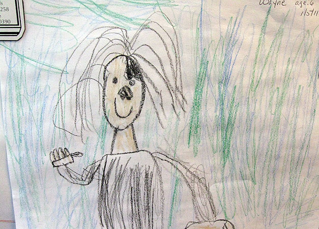 A drawing by a 6-year-old American Indian boy who was adopted by a relative hangs in Dawn Blanchard's office. Blanchard is the ombudsperson for American Indian Families and reviews hundreds of child protection cases a year.
