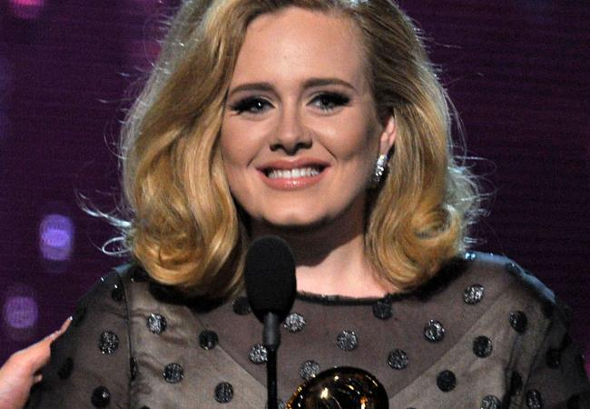 Singer Adele accepts the award for 'Song of the Year' onstage at the 54th Annual GRAMMY Awards held at Staples Center on February 12, 2012 in Los Angeles, California.