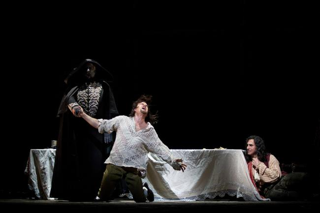 "James Morris as the Commendatore, Gerald Finley as the title character, and Kyle Ketelsen as Leporello in Mozart's ""Don Giovanni."" (Marty Sohl/Metropolitan Opera)"