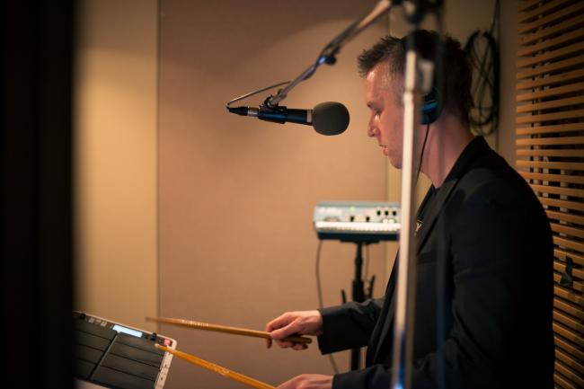 A member of Thomas Dolby's band in The Current studio.