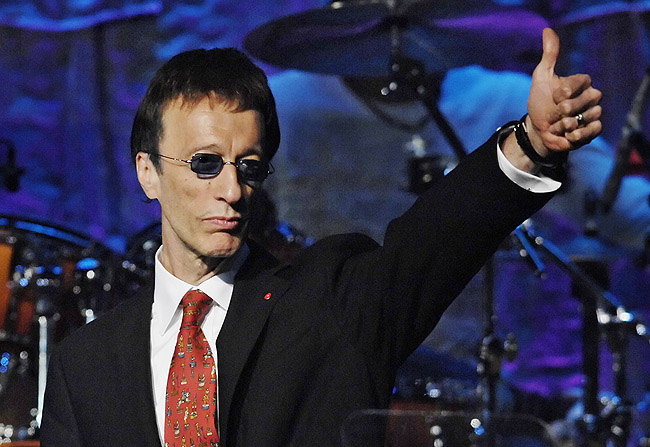 In this May 15, 2007, file photo, The Bee Gees' Robin Gibb salutes the crowd after The Bee Gees were named BMI Icons during the 55th Annual BMI Pop Awards in Beverly Hills, Calif. A representative said on Sunday, May 20, 2012, that Gibb has died at the age of 62. (AP Photo/Chris Pizzello, File)