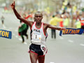Moses Tanui of Kenya crosses the finish line to wi