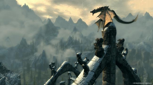 The mountains of Skyrim behind a dragon. (Bethesda Softworks LLC)