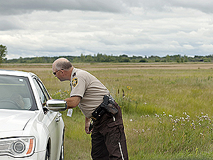 Chief deputy Karl Erickson checks on a motorist