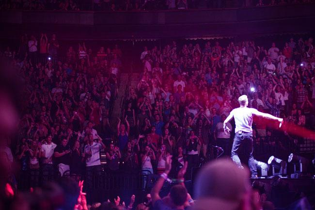Coldplay lead singer Chris Martin greets the crowd at the Xcel Energy Center.