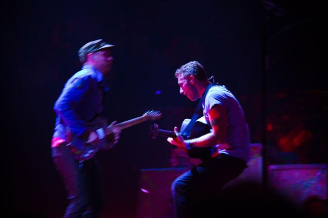 Jonny Buckland and Chris Martin of Coldplay at the Xcel Energy Center.