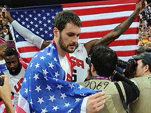 US forward Kevin Love celebrates after w