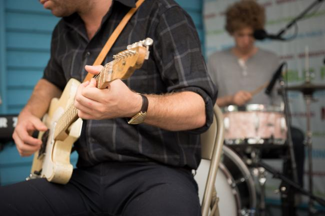 Dawes performs at the MPR booth at the Minnesota State Fair