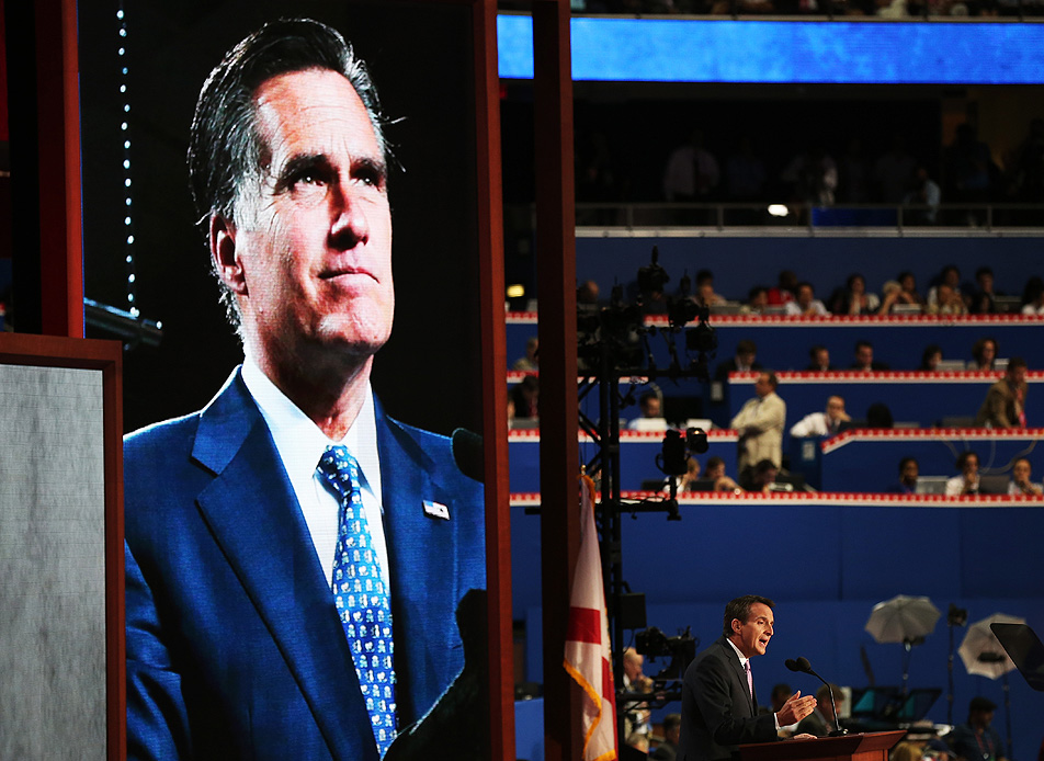 Dwarfed by an image of Romney