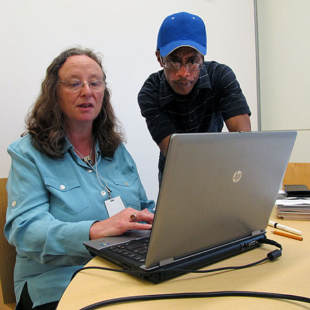 Nancy Cohen, an employment support consultant for at the Minneapolis Workforce Center run by Goodwill-Easter Seals, helps Marcus Cook, Sept. 5, 2012, at the Hennepin County Central Library in downtown Minneapolis. Cook, 47, is a recent transplant from Chicago. He came here looking for work in the restaurant and hospitality industry.