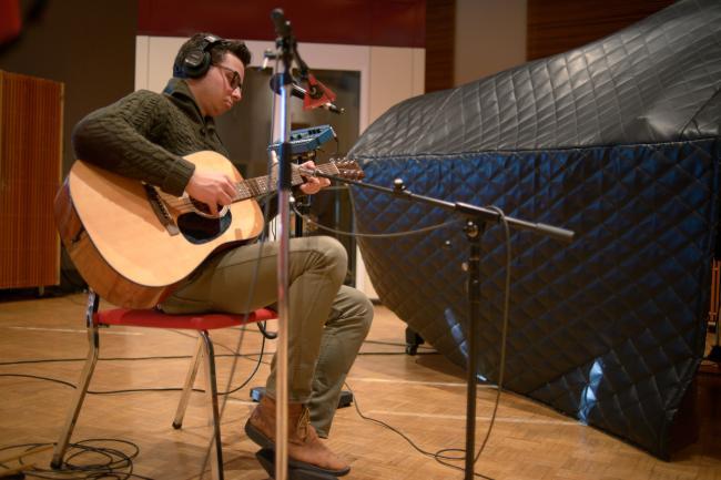 Guitarist Ian Hutlquist of Passion Pit accompanied singer Michael Angelakos in the studio.