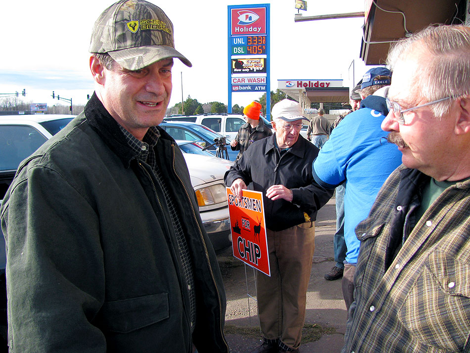 Rep. Chip Cravaack speaks with supporters Saturday, Nov. 3, 2012 outside a Duluth-area bait and gun store.