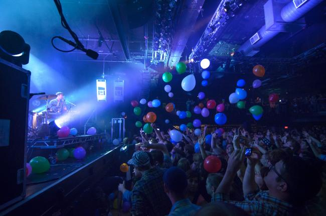 Matt and Kim threw uninflated balloons out into the audience, and the audience filled them.