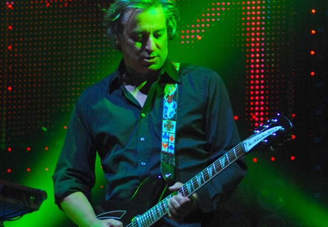 Peter Buck plays with R.E.M. in 2008.