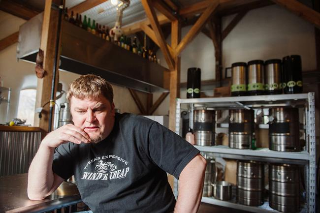 Ken Thiemann sits in the brewery he built.