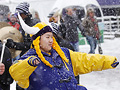 A Vikings fan dances in the snow