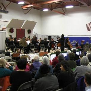 The Hiland Mountain Correctional Center orchestra performs a concert on December 8, 2012.