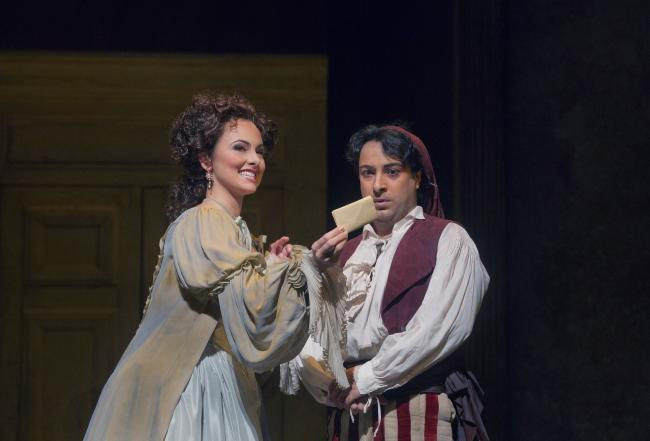 "Isabel Leonard as Rosina and Rodion Pogossov as Figaro in Rossini's ""The Barber of Seville."" (Ken Howard/Metropolitan Opera)"