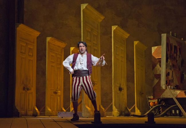 "Rodion Pogossov as Figaro in Rossini's ""The Barber of Seville."" (Ken Howard/Metropolitan Opera)"