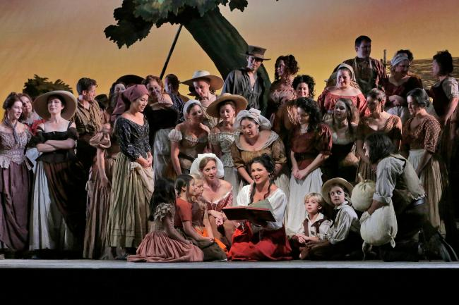 "Anna Netrebko (center) as Adina in Donizetti's ""L'Elisir d'Amore."" (Ken Howard/Metropolitan Opera)"