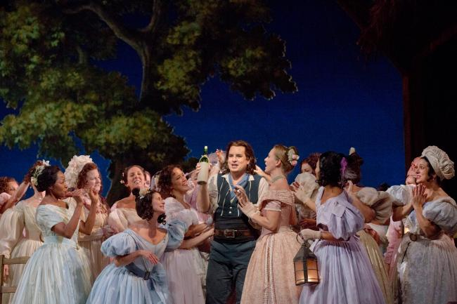 "Matthew Polenzani (center) as Nemorino in Donizetti's ""L'Elisir d'Amore."" (Ken Howard/Metropolitan Opera)"