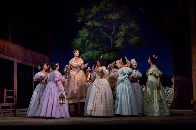 "Anne-Carolyn Bird (on platform) as Giannetta in Donizetti's ""L'Elisir d'Amore."" (Ken Howard/Metropolitan Opera)"