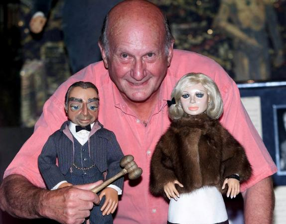 Thunderbirds creator Gerry Anderson has died at age 83. Here, he poses with puppets Parker and Lady Penelope from the series.