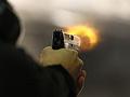 Brett Nielsen fires an Glock handgun