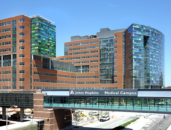 A glass walkway connects the new Johns Hopkins Hospital with a parking ramp at its Baltimore flagship location. The hospital opened in 2012 and features a 1.6 million-square-foot building on five acres. The building cost $1.1 billion. Of that, Hopkins borrowed about $400 million for the facility, raised about $325 million from private philanthropic sources, and received $100 million from the Sstate of Maryland.