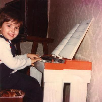 Roberto Plano, three years old, plays his first instrument, the Bontempi organ.