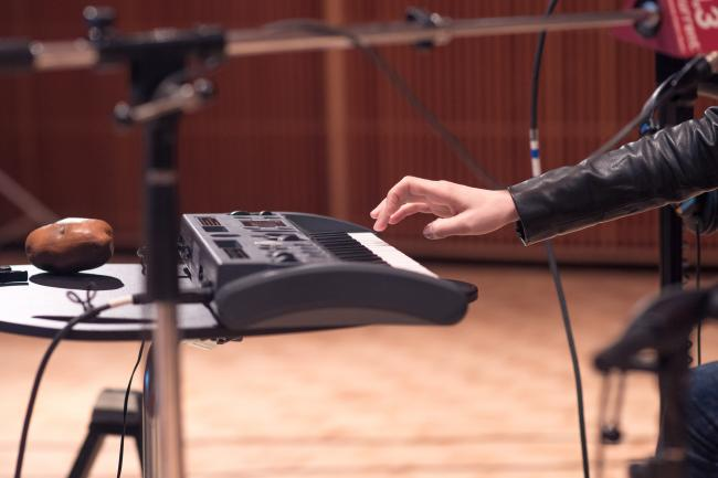 Sara Quin plays keyboards in The Current studio.