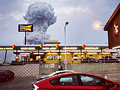 A plume of smoke rises from the fertilizer plant