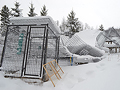 Snow caved in a cage